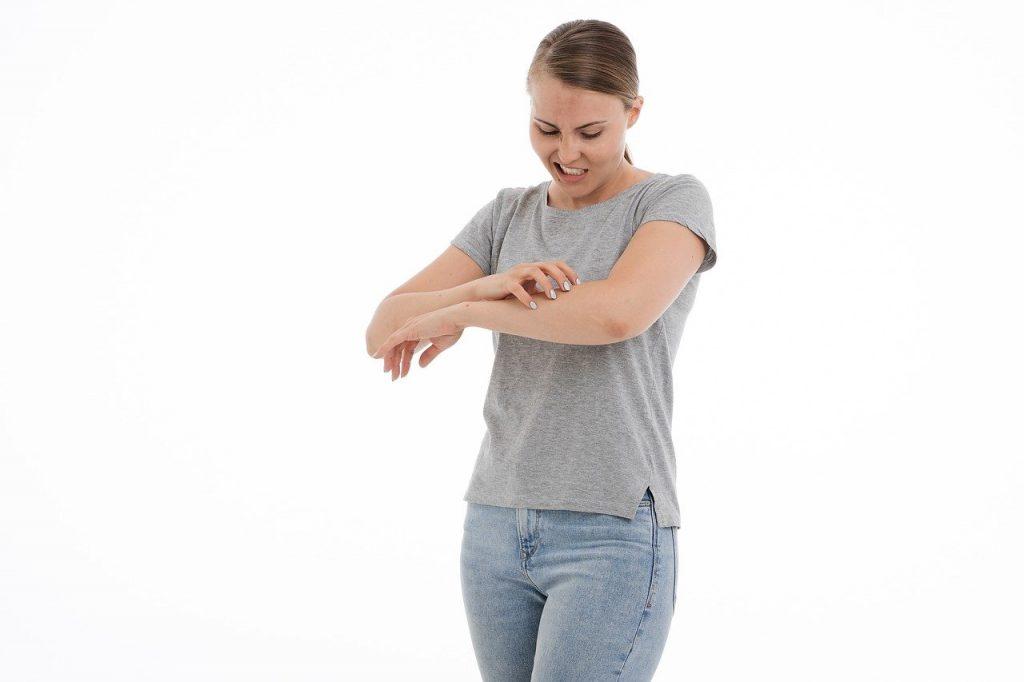 scratching skin due to pruritus or itching