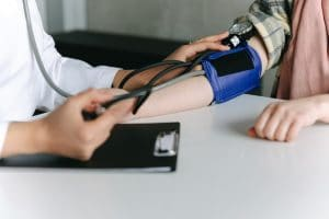 blood pressure check for hypotension or low BP